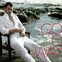 Australian actor Chris Hemsworth, wet at the beach in a white outfit for a hot Flaunt magazine photo shoot.