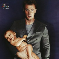 Chris Evans poses with a baby for the GQ magazine photoshoot.